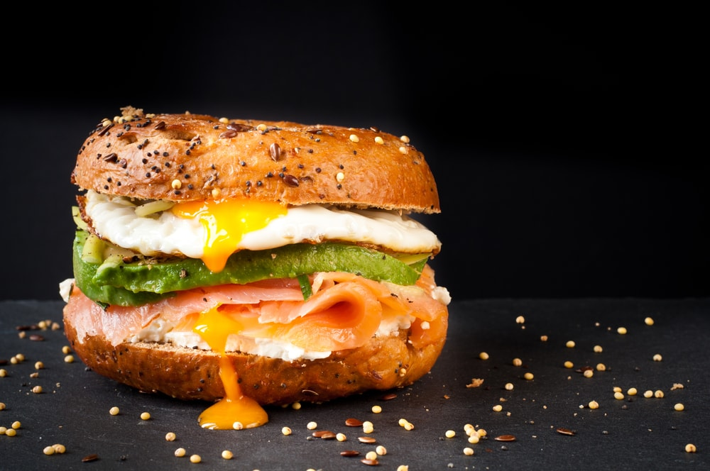 Bagel with avocado and fried egg