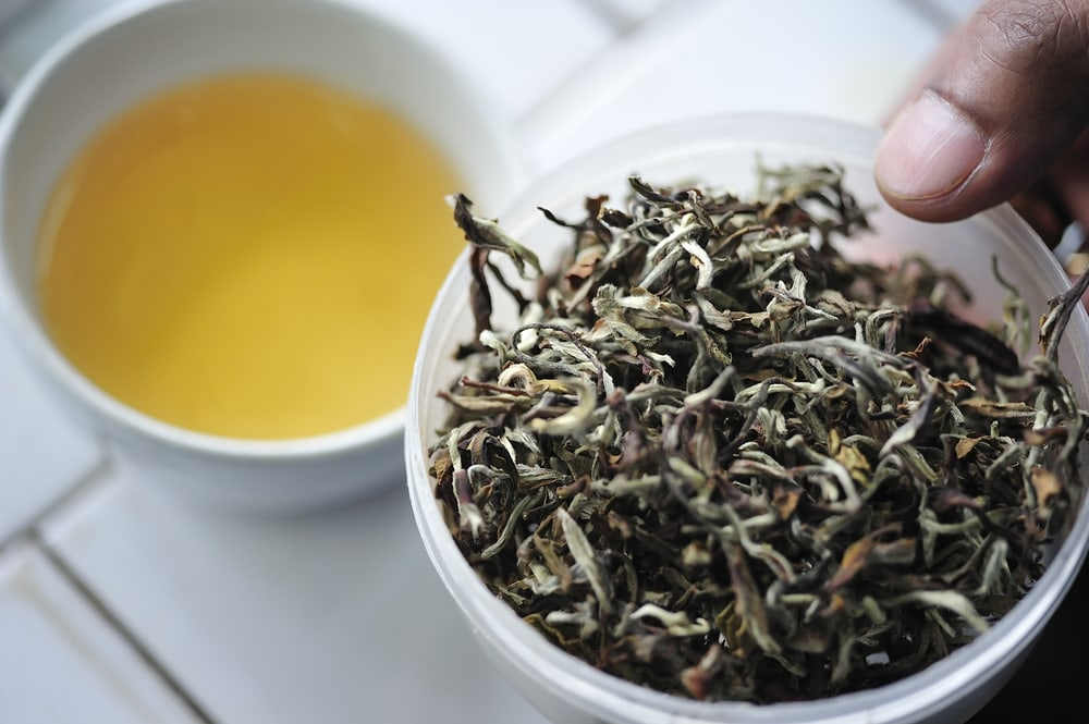 Dried Darjeeling Tea Leaves and a Cup of Tea