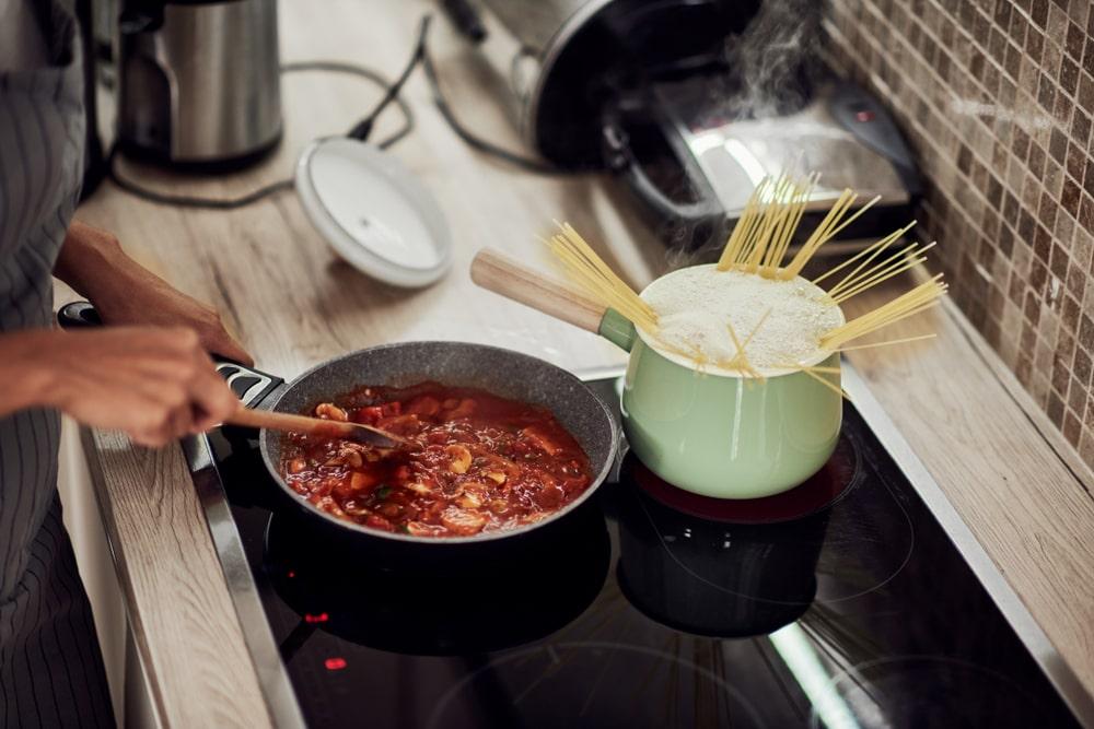 Woman Simmering Sauce