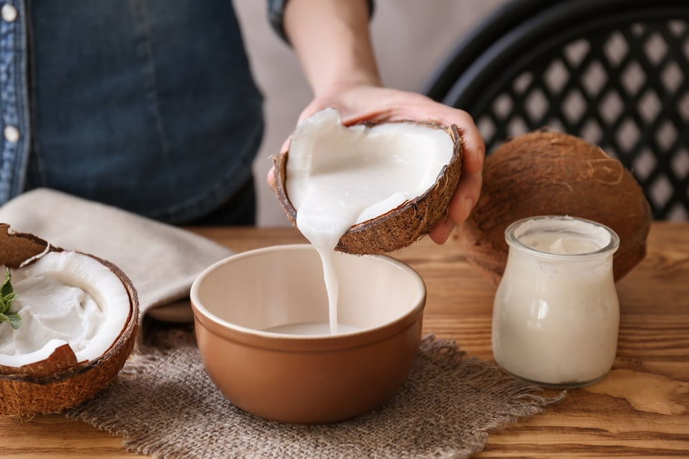 Woman Pouring Coconut Milk