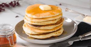 Homemade Cracker Barrel Pancakes With Butter and Maple Syrup