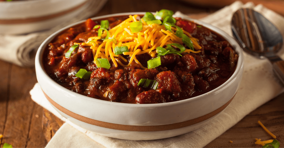 Chili Con Carne with Cheese and Chopped Onions
