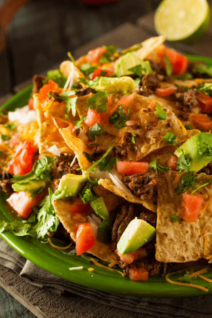 Loaded Nachos with Avocado, Tomatoes and Chopped Onions