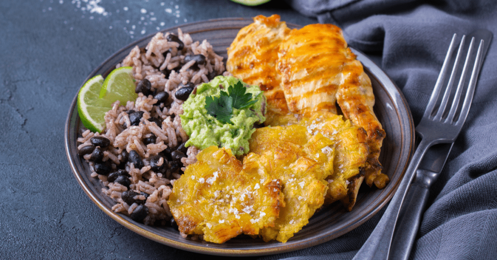 Caribbean Food: Rice with Black Beans, Fried Plantains, Chicken and Guacamole