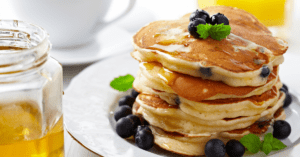 Stacks of Blueberry Pancakes with Maple Syrup