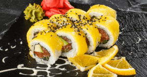 Sushi Rolls with Mango on Top