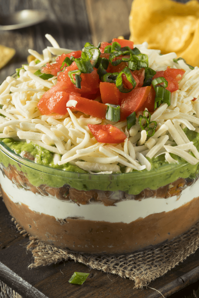 Seven Layer Taco Dip with Sour Cream, Guacamole and Red Beans