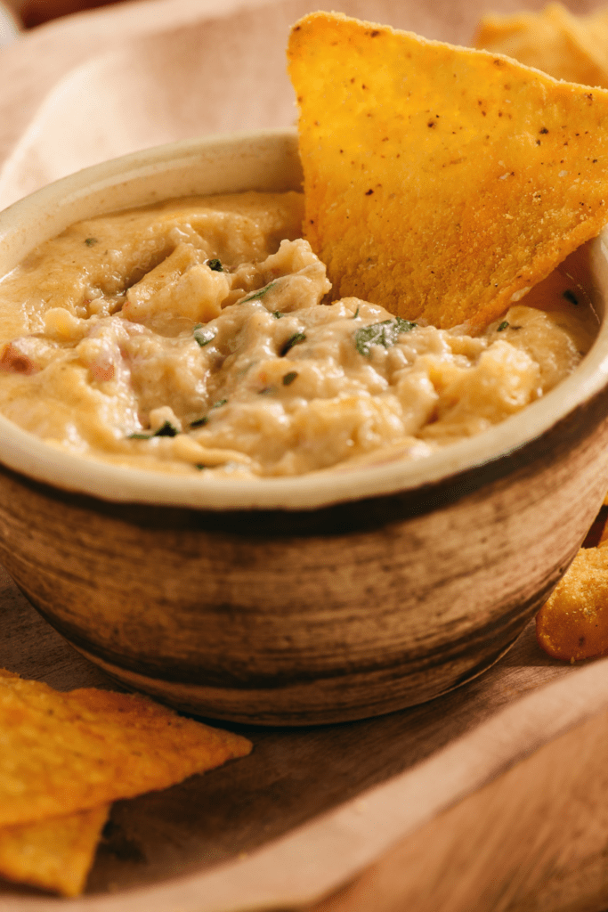 Bowl of Cheese Dip with Tacos