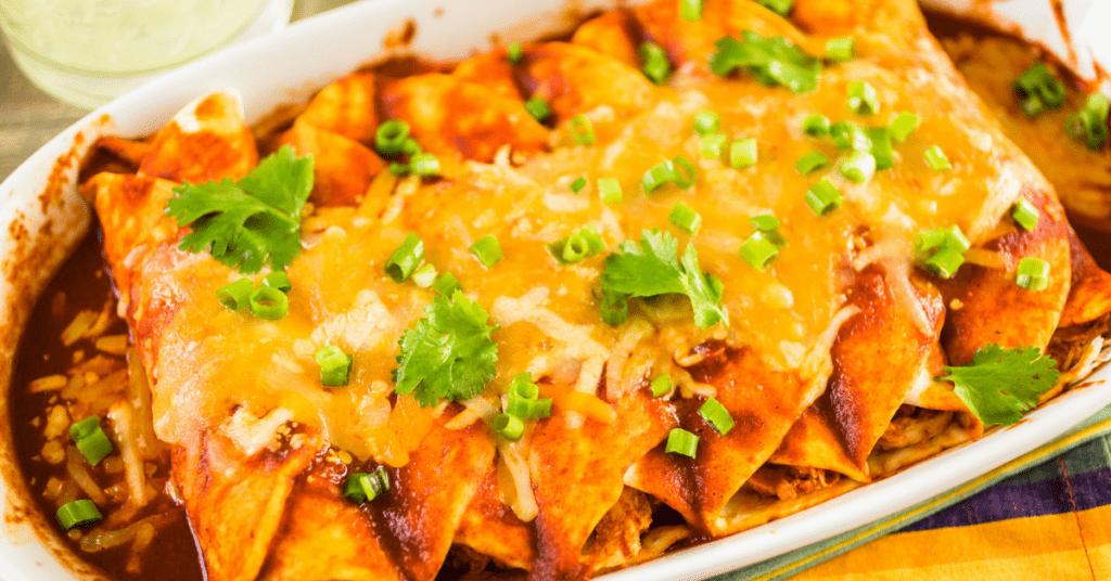 Chicken enchiladas smothered with cheese