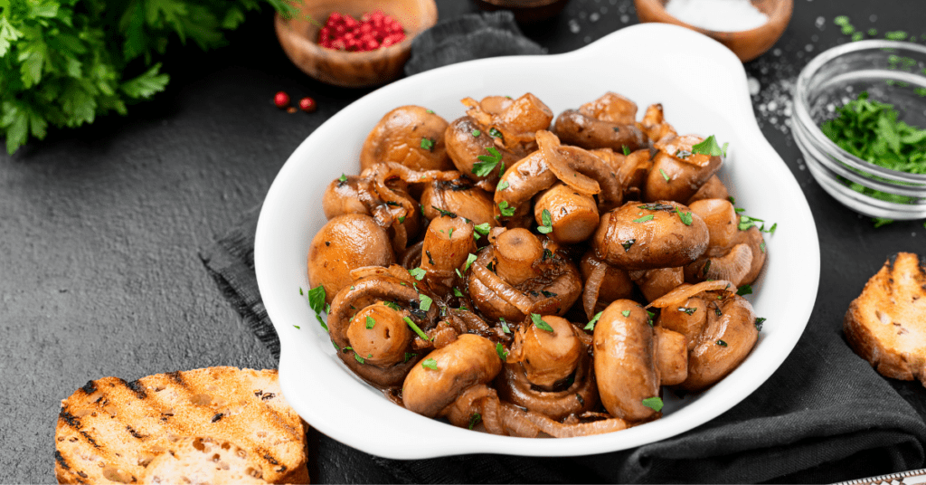 Button mushrooms in a white bowl