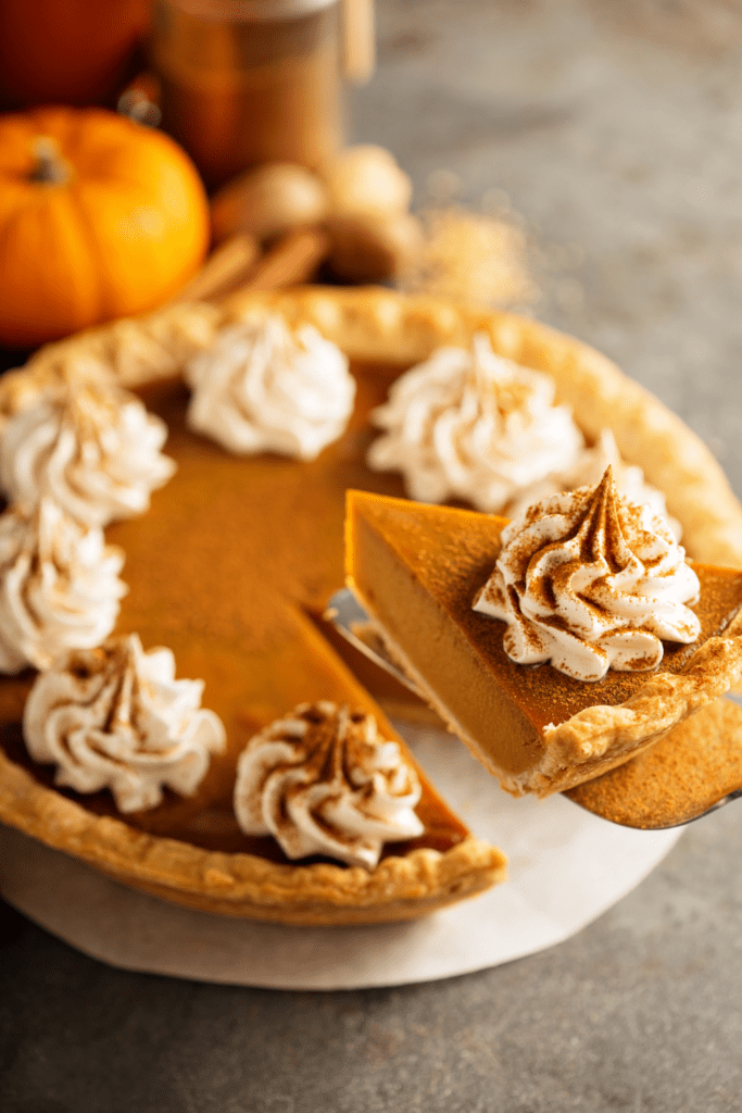 Pumpkin Pie with Cinnamon  and Whipped Cream