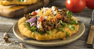 Fry Bread Tacos with Ground Beef, Lettuce and Tomatoes