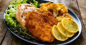 Homemade German Schnitzel with Lemons and Potatoes