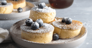 Homemade Japanese Pancakes with Powdered Sugar and Blueberries