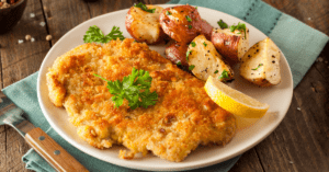 Breaded Chicken with Potatoes and Lemons