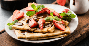 French Crepes with Strawberry and Chocolate Syrup