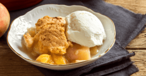 Homemade Peach Cobbler with Ice Cream on Plate