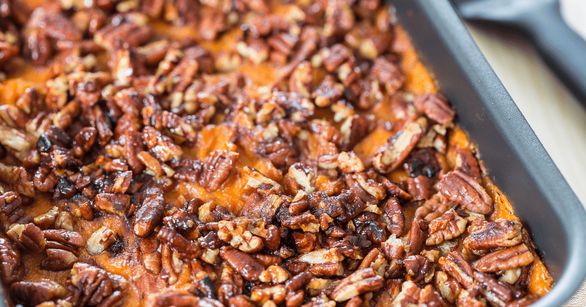 Masehd Sweet Potato Casserole Topped with Caramelized Pecans