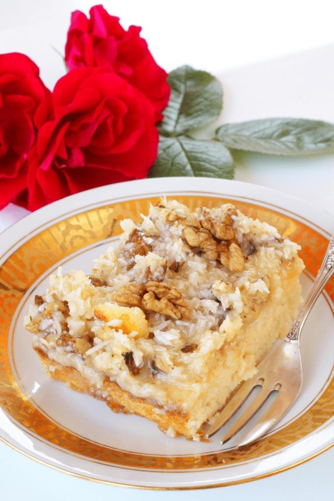 Slice of Cake with Walnuts and Coconut Icing