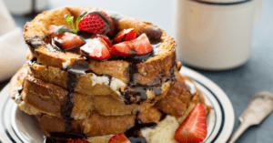 Stacks of French Toast with Strawberry Toppings