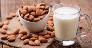 Almond Milk in a Glass with Almonds