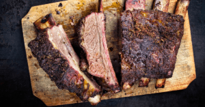 Barbecue Chuck Beef Ribs in a Wooden Cutting Board