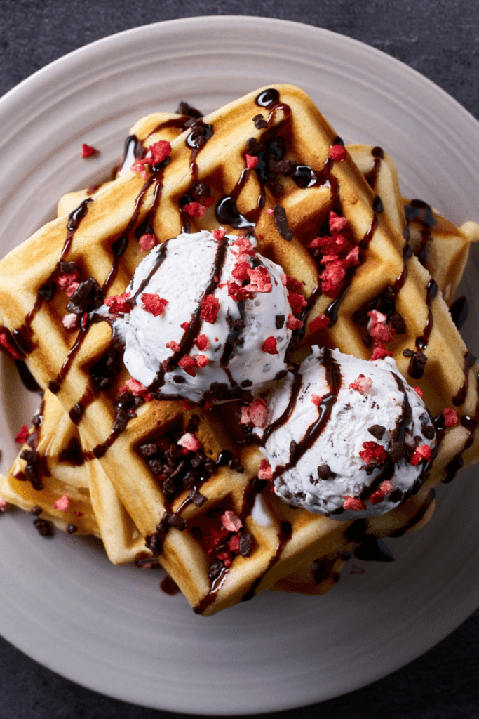 Belgian Waffles with Chocolate Syrup and Ice Cream