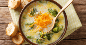 Broccoli Cheddar Soup in a Bowl with Bread