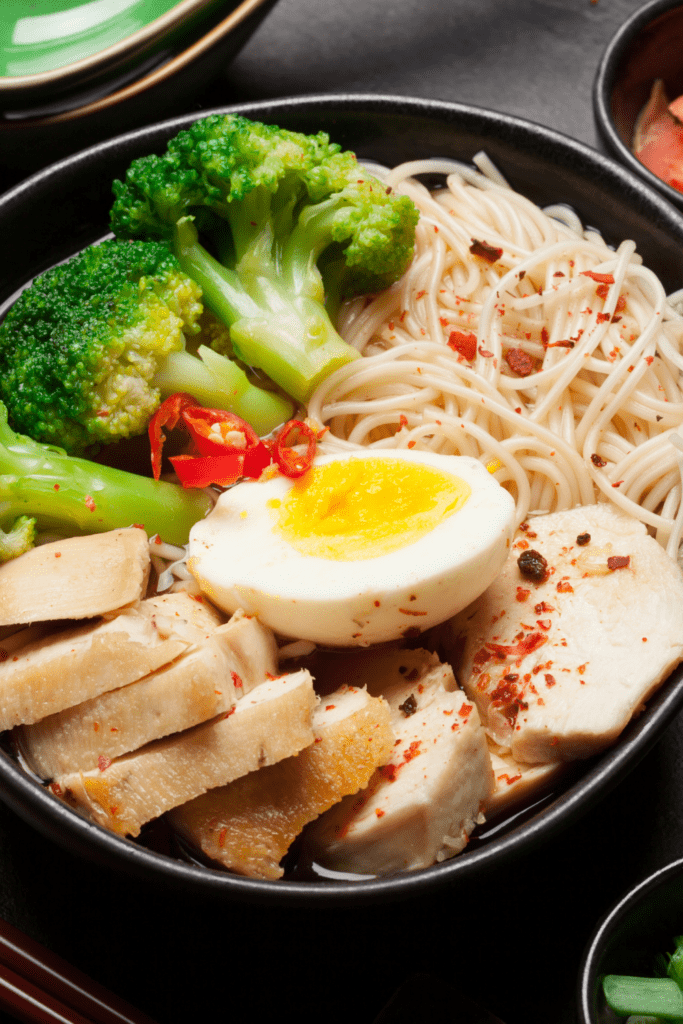 Chinese chicken, noodles, broccoli, and egg