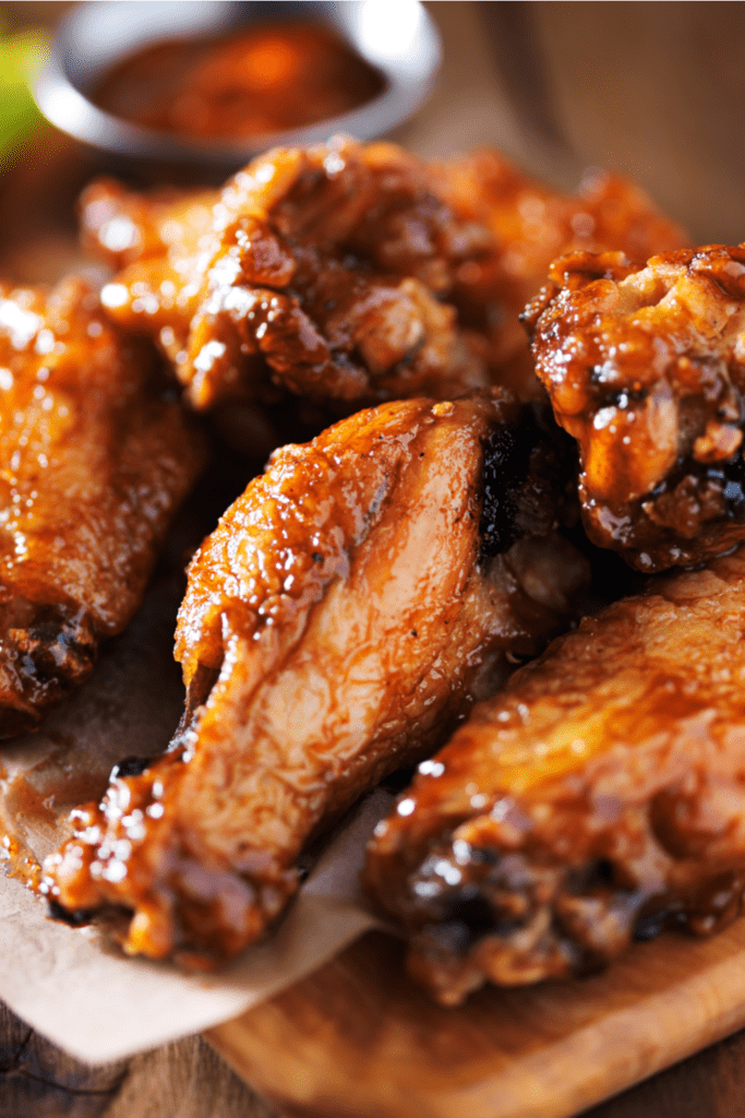 Homemade Barbecue Chicken Wings in a Wooden Chop Board