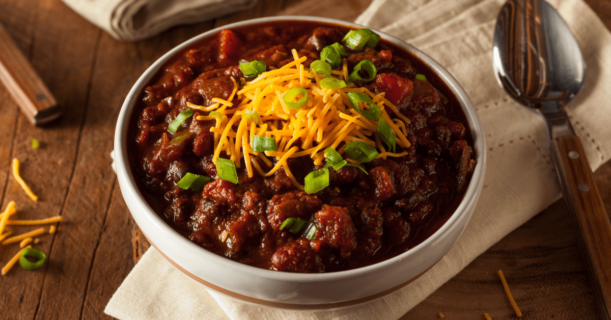 Homemade Bowl of Chili with Cheese and Chopped Onions
