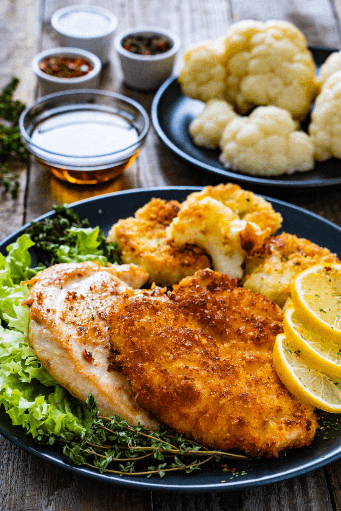 Homemade German Schnitzel with Potatoes and Cauliflower