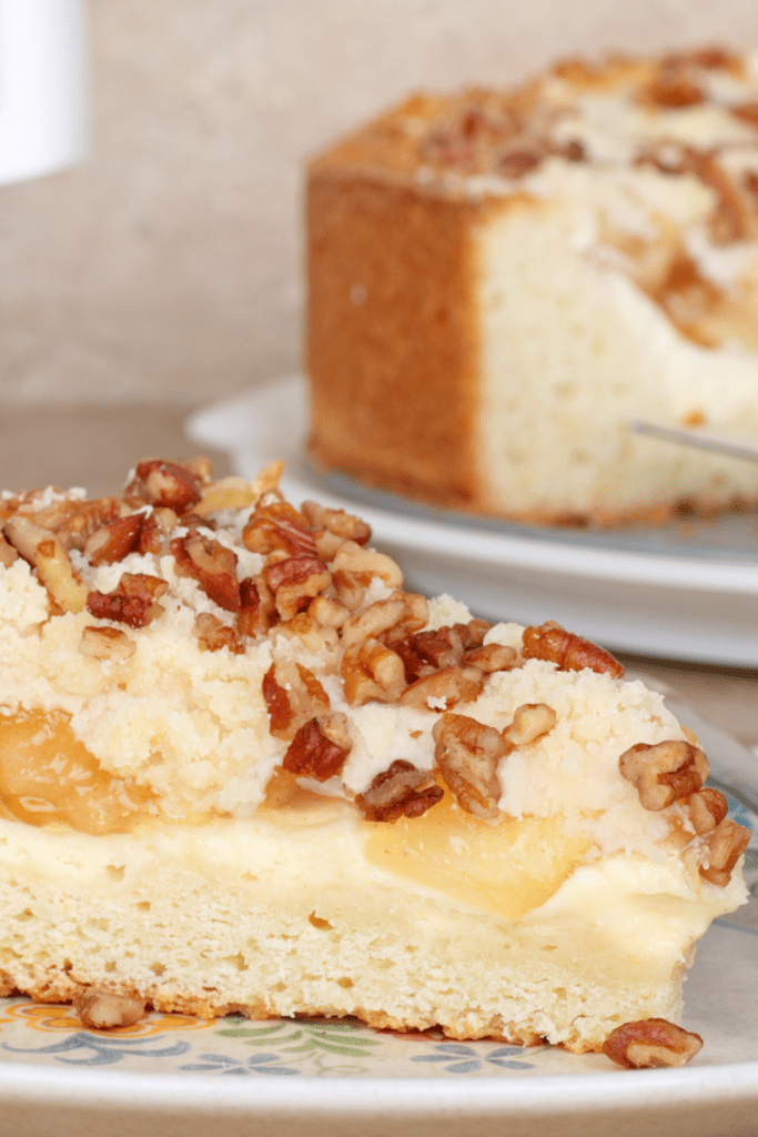 Slice of Cream Cheese Coffee Cake with Nuts on Top
