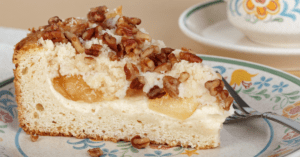 Slice of Homemade Cream Cheese Coffee Cake with Nuts