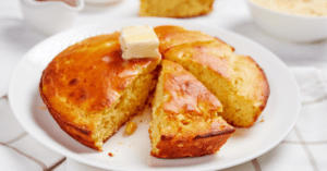 Slices of Homemade Cornbread Topped with Melted Butter