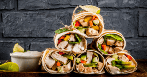 Stacks of Homemade Buffalo Chicken Wraps with Vegetables