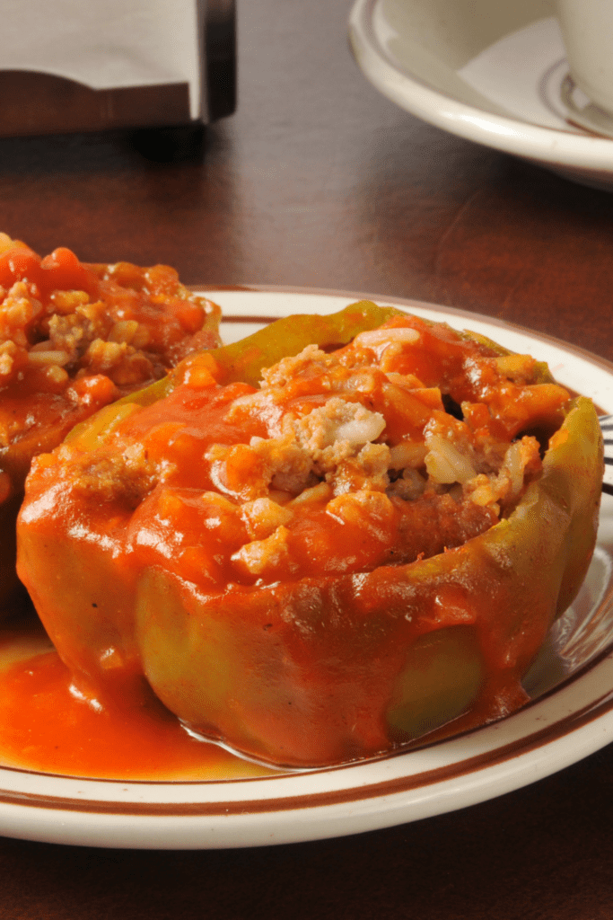 Stuffed Bell Peppers with Ground Beef Rice and Tomato Sauce