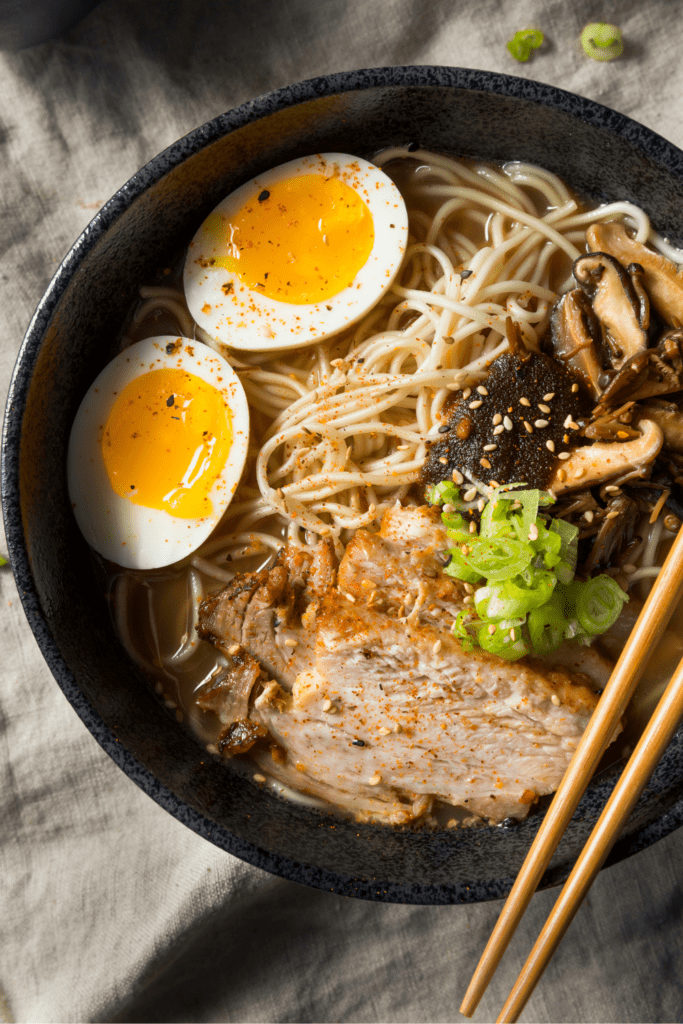 Asian Pork Ramen with Egg in a Black Bowl