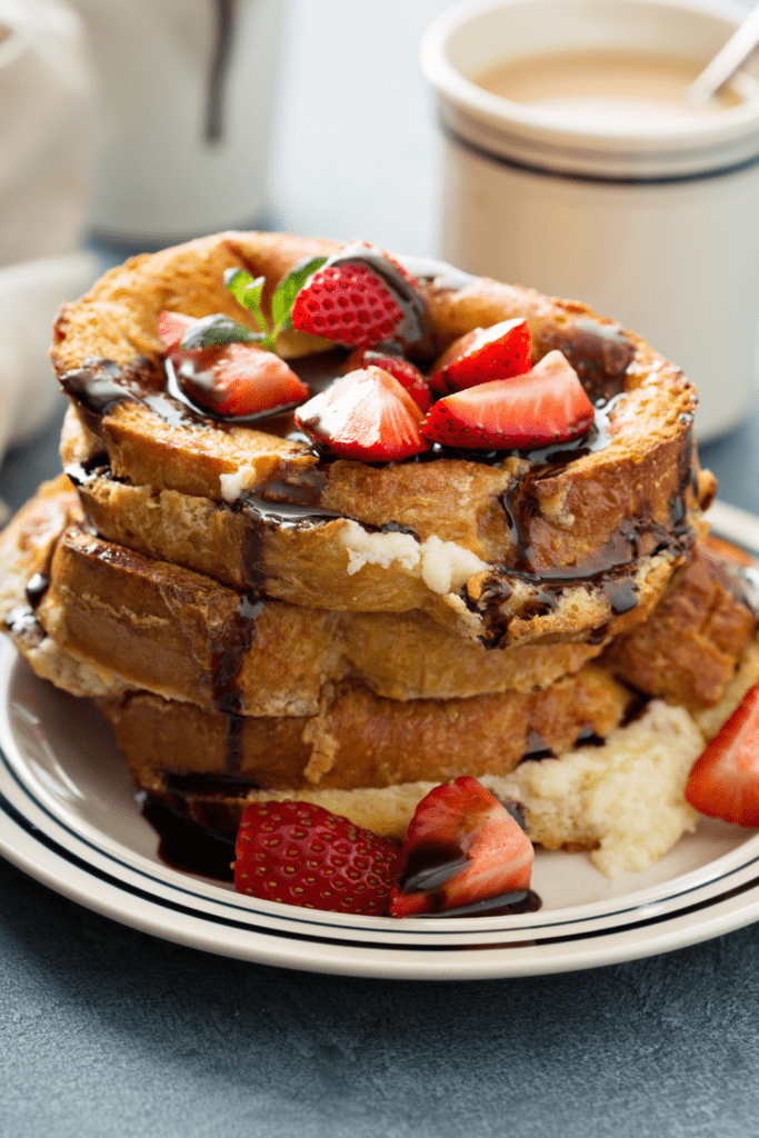 French Toast with Strawberries and Chocolate Syrup