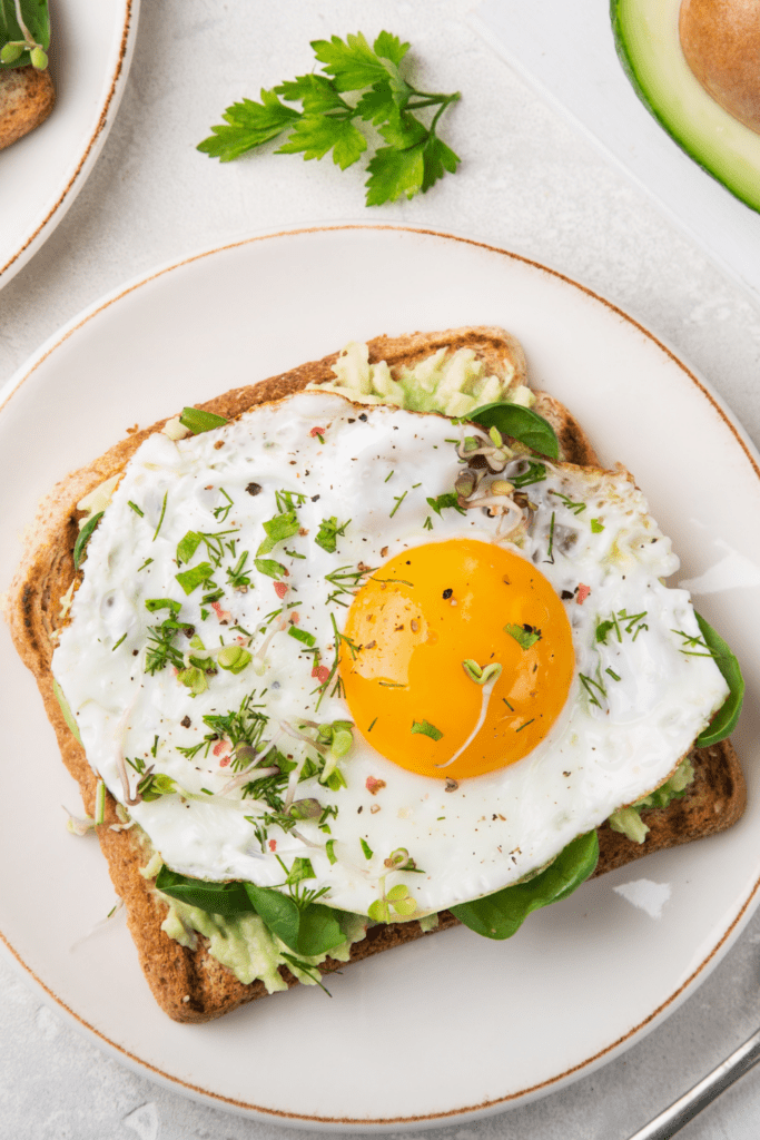 Homemade Avocado Toast with Fried Egg and Spinach