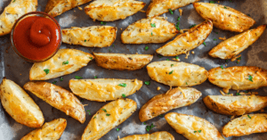Homemade Baked Potato Wedges with Herbs and Tomato Sauce