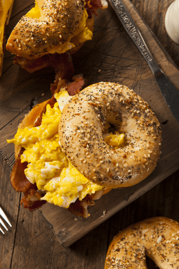 Homemade Breakfast Bagel Sandwich with Bacon, Egg and Sesame Seeds