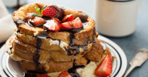 Homemade French Toast with Strawberries and Chocolate Syrup
