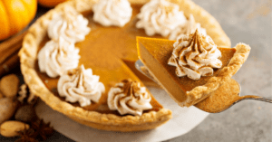 Homemade Pumpkin Pie with Whipped Cream and Cinnamon