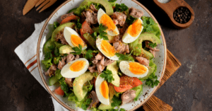Homemade Salad with Canned Tuna, Egg, Avocadoes, Lettuce and Tomatoes