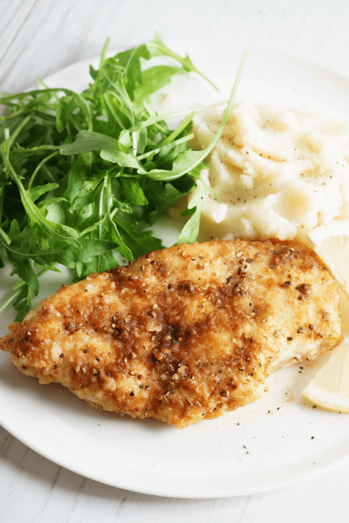 Melt in Your Mouth Chicken Served with Mashed Potato and Arugula