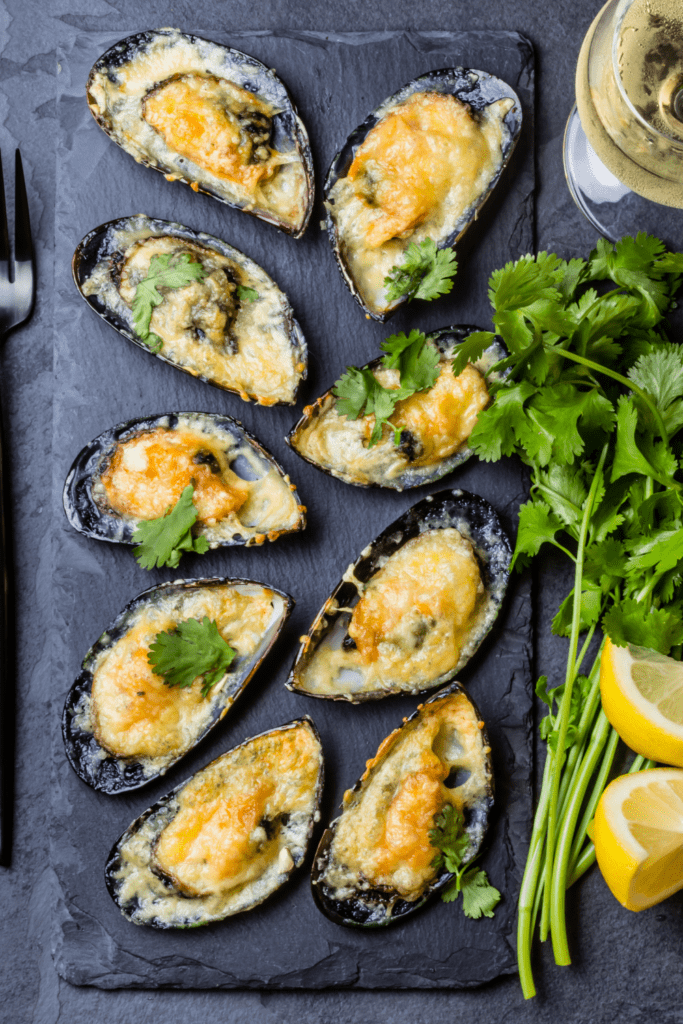 Baked Mussels with Cheese, Cilantro and Lemons