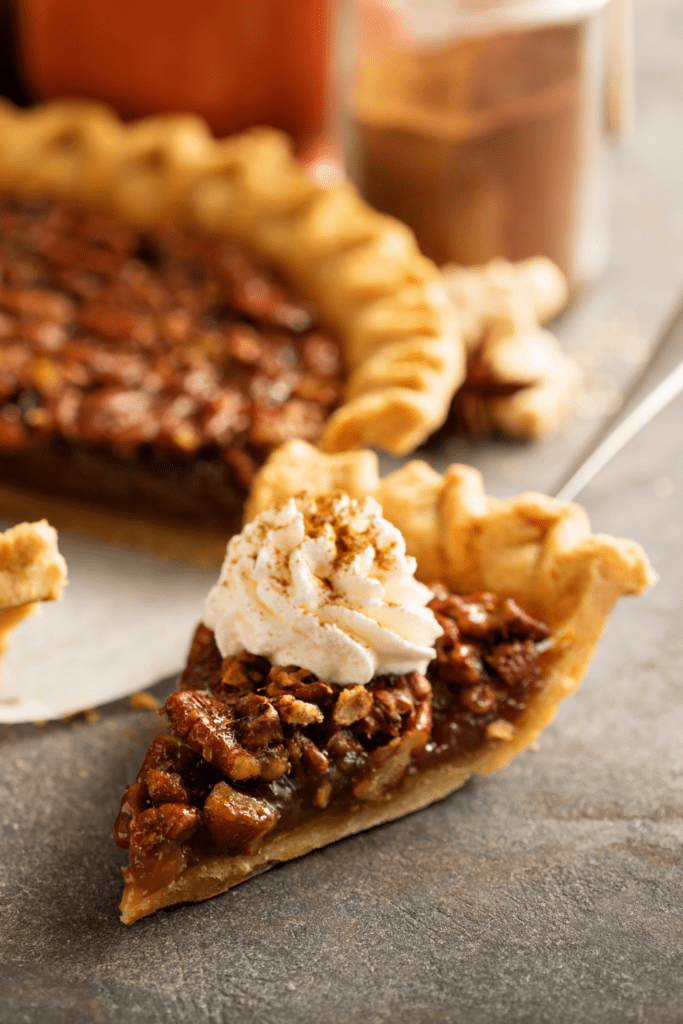 Sliced Pecan Pie with Whipped Cream
