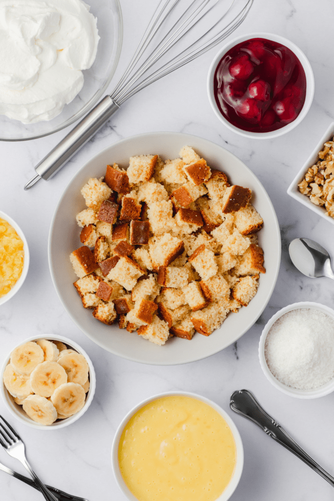 Punch Bowl Cake Ingredients: Croutons, Sliced Bananas, Coconut Flakes, Whipped Cream and Walnuts