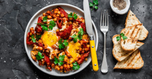 Shakshuka with Eggs, Chickpeas and Bread